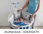 mother in a blue jacket stands... | Shutterstock . vector #636342674