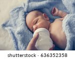 mother feeding one weeks old... | Shutterstock . vector #636352358