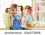 happy kids eating healthy food... | Shutterstock . vector #636373808