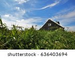 A Traditional Wooden House In...