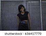 a young brunette woman leans... | Shutterstock . vector #636417770