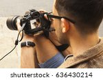 young photographer viewing his... | Shutterstock . vector #636430214