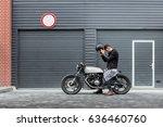 handsome rider man put on black ... | Shutterstock . vector #636460760