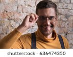 positive young bearded man... | Shutterstock . vector #636474350