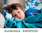 sick child lying on couch at... | Shutterstock . vector #636501020