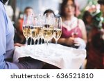 the waiter carries a tray with... | Shutterstock . vector #636521810