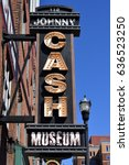Small photo of NASHVILLE, TENNESSEE, USA - MAY 01, 2017: Johnny Cash museum exterior neon sign advertisement at Nashville, Tennessee.