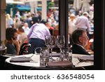 Small photo of LONDON, UK - April 30, 2014: People at an open-air cafe in Covent Garden. One of the main tourist attractions in London, Covent Garden is known for its restaurants,pubs,market stalls and shops.