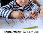little child hand holding... | Shutterstock . vector #636574658