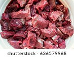 bowl of raw diced wild boar and ... | Shutterstock . vector #636579968