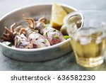 fresh whole calamari cooked in... | Shutterstock . vector #636582230