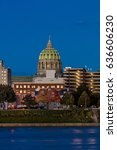 Small photo of OCTOBER 25, 2016 - HARRISBURG, PENNSYLVANIA, City skyline and State Capitol shot at dusk from Susquehanna River, PA