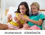 siblings listening to music... | Shutterstock . vector #636606626