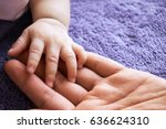 hand baby in the hand of mother ... | Shutterstock . vector #636624310
