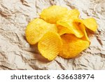 chips on paper background | Shutterstock . vector #636638974