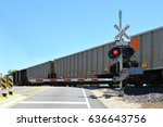 Freight Train At Crossing Gate