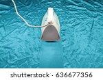 iron on crinkle silk fabric | Shutterstock . vector #636677356