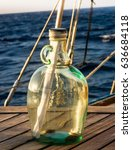 Small photo of Message in a bottle ready to be thrown into the ocean.