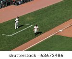 Small photo of SAN FRANCISCO, CA - OCTOBER 19: San Francisco Giants vs. Philadelphia Phillies: Cody Ross takes long lead from third game three NLCS 2010 October 19, 2010 AT&T Park San Francisco.