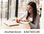attractive young woman writing... | Shutterstock . vector #636760138