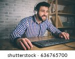 bearded man playing at home and ... | Shutterstock . vector #636765700