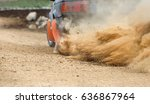 rally car turning in dirt track | Shutterstock . vector #636867964