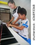 Small photo of September 15, 2014: elementary school students in Jiangxi, Shuangfeng, learn to play the piano in the electronic piano classroom in Jiujiang. The piano was donated by an alumnus.