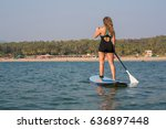 girl standing on a paddle board ...   Shutterstock . vector #636897448