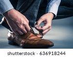 man tying shoelaces | Shutterstock . vector #636918244