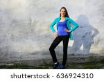 smiling young woman standing... | Shutterstock . vector #636924310