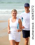 athletic couple running by the... | Shutterstock . vector #63692572