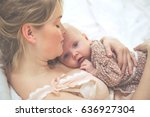 mom with a baby  | Shutterstock . vector #636927304