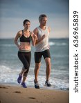 a couple wearing sportswear is... | Shutterstock . vector #636965839