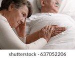 Elderly Woman Holding Sick...