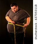 man belly fat with tape measure ...   Shutterstock . vector #637053118