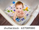 the child is sitting in an... | Shutterstock . vector #637089880