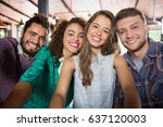 portrait of cheerful friends in ... | Shutterstock . vector #637120003