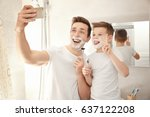 father and son taking selfie... | Shutterstock . vector #637122208