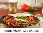 Small photo of Meat Saute Turkish Et sote with wooden table - Hair Pie Meat - Sac Tava - Sac Kavurma