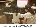 child girl in piano class. | Shutterstock . vector #637148698
