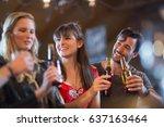 smiling friends holding beer... | Shutterstock . vector #637163464