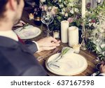the groom holding the bride... | Shutterstock . vector #637167598