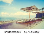 umbrella and chair with... | Shutterstock . vector #637169359