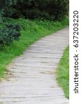 Pathway In A Park Leading To A...