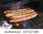 grilling sausages on barbecue... | Shutterstock . vector #637227280