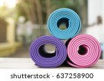 yoga mat on the wooden table | Shutterstock . vector #637258900