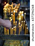 hand lighting  candles in a... | Shutterstock . vector #637296268