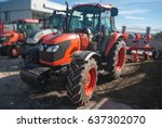 Small photo of A close-up of a new tractor. Agricultural soil cultivation machine. Concept agro culture.