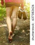 Bare Feet Walking Along The...