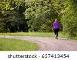 lonely lady walking on path ... | Shutterstock . vector #637413454